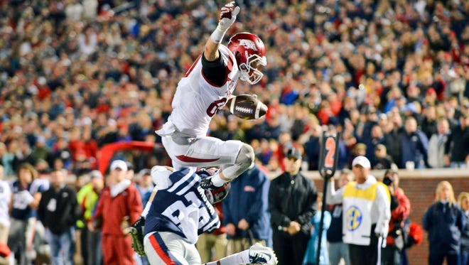 Ole Miss dropped from the major college football polls after its 53-52 loss to Arkansas.