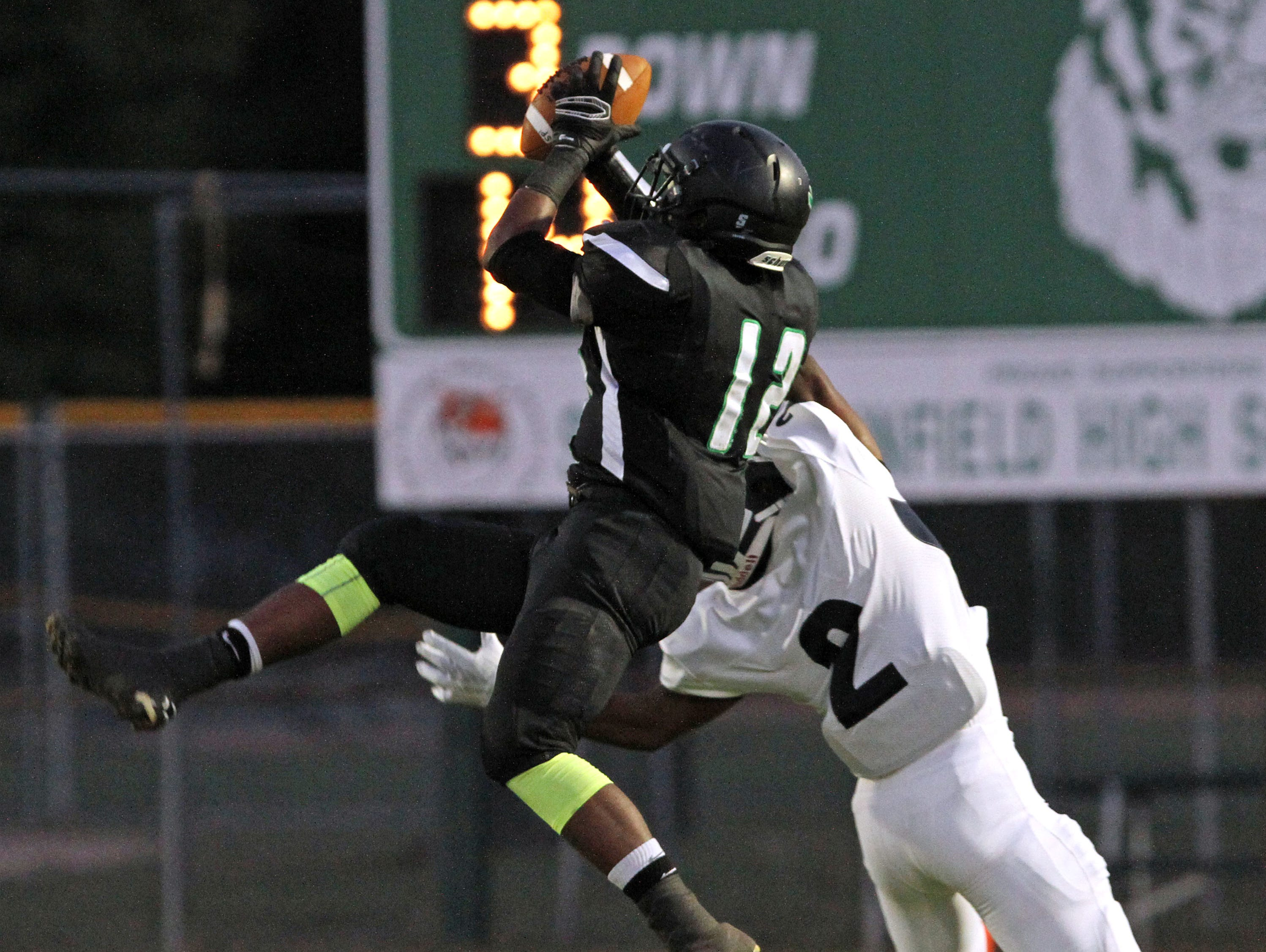South Plainfield's Jason Lee makes a reception for a loss of yards in football game of New Brunswick at South Plainfield.