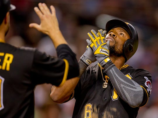Pittsburgh Pirates center fielder Starling Marte reacts after hitting a three-run homer in the fourth inning on June 12, 2018, during the Arizona Diamondbacks' matchup against the Pittsburgh Pirates at Chase Field in Phoenix, Arizona. The Diamondbacks have traded for Marte.