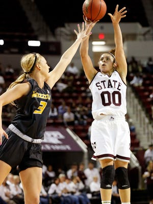 Mississippi State's Dominique Dillingham (00) shoots a 3-pointer over Missouri's Sophie Cunningham.