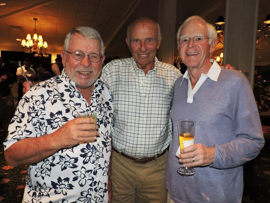 "Gary Parlin, left, Mort Seaman and Frank Noonan share a laugh at the sold-out ""An Evening in the Tropics"" fundraiser for Hibiscus Children's Center."