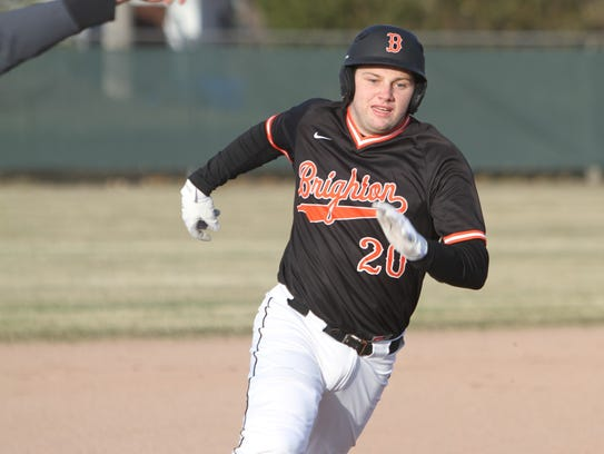 Brighton's Andrew Gilpin rounds third base and heads
