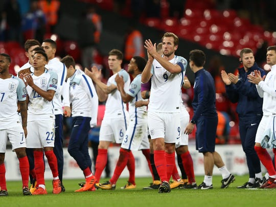 England's players applaud the crowd after the 2018 FIFA World Cup qualifying match against Slovenia at Wembley Stadium in London, on Oct. 5, 2017.