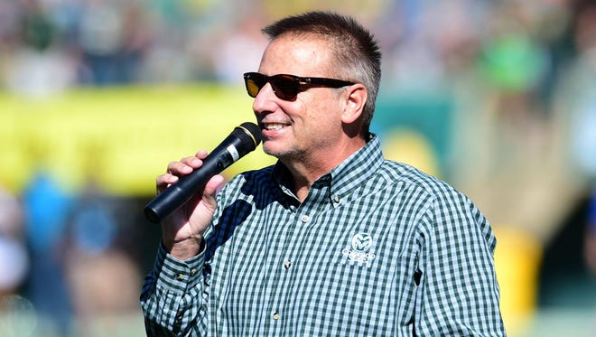 CSU basketball coach Larry Eustachy addresses the crowd at Hughes Stadium during halftime of the Rams' football game against Air Force.