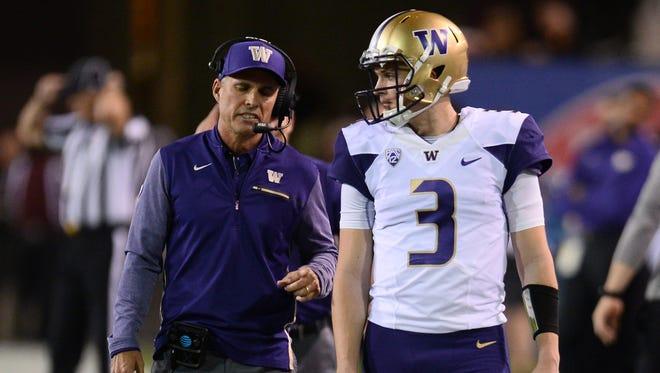 Huskies coach Chris Petersen has developed a reputation as a quarterback guru for his work with Jake Browning and others.