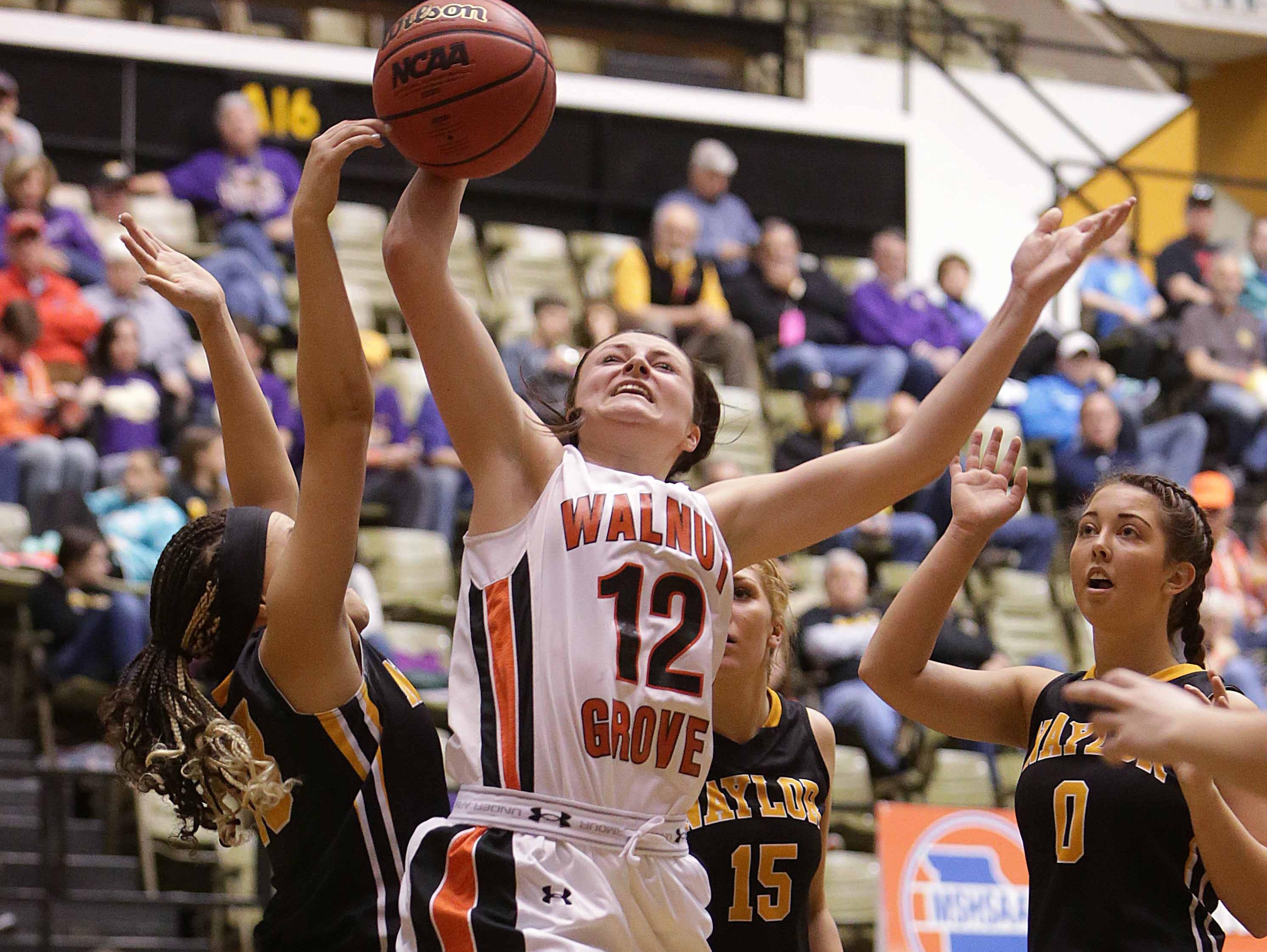 Walnut Grove's Bayley Harman (12) drives to the basket.