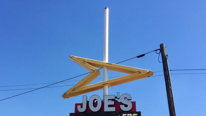 The colorful Roto-Sphere sign that slowly spins is missing again, this time for further repairs.