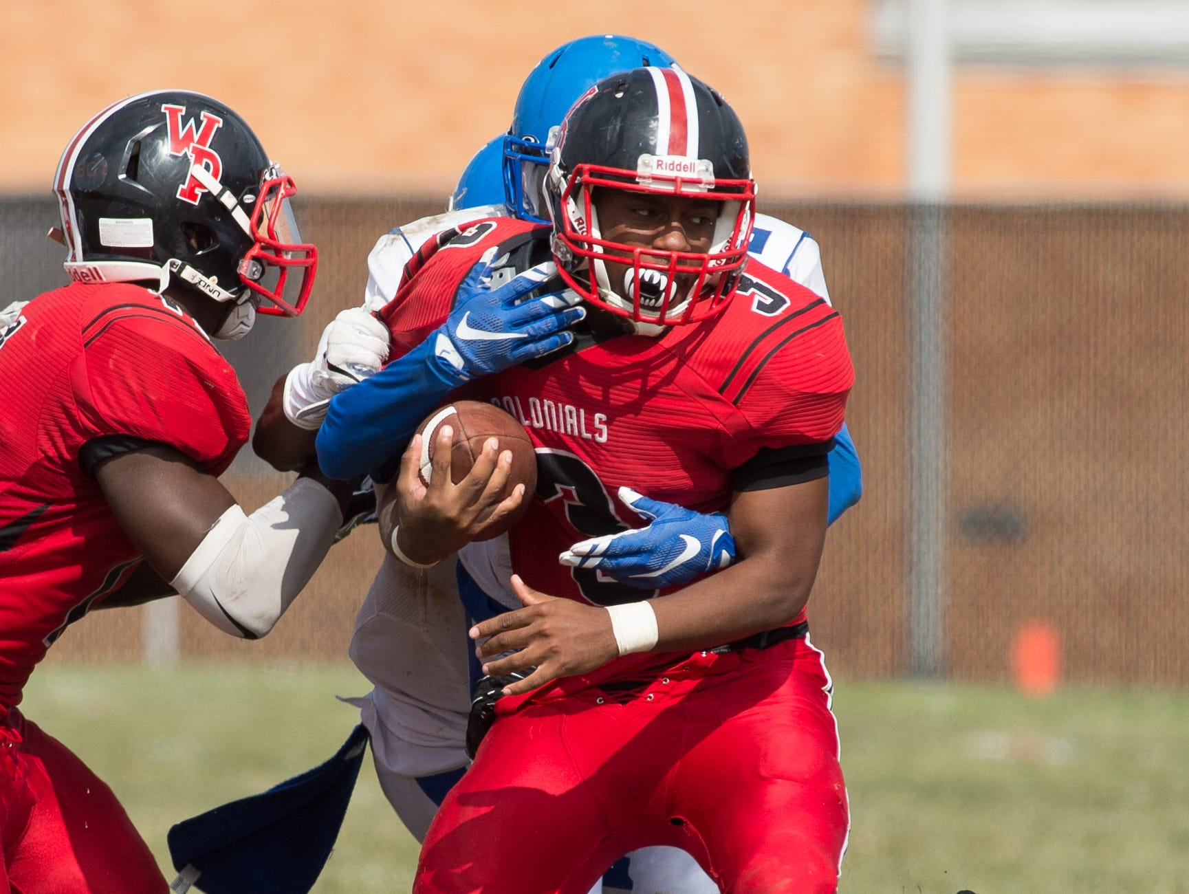 William Penn's Joe Greenwood (3) tries to run with the ball in their game against Middletown.