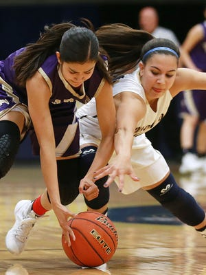 Burges' Becca Cardenas, left, nad Coronado's Laura Milliorn hustle after a loose basketball during first quarter action Tuesday at Coronado.