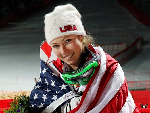 Mikaela Shiffrin (USA) celebrates winning gold in ladies' alpine skiing slalom.