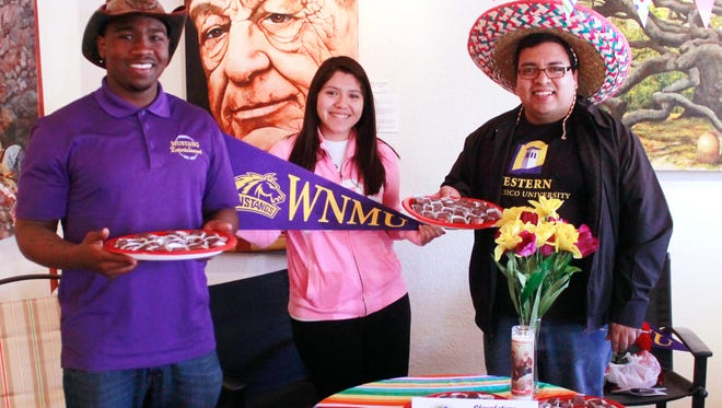 WNMU students and staff, Khari Bailey, from left, AsiaMarie Garcia, and Abe Villarreal handed out Mexican chocolate-flavored treats at Chocolate Fantasia.