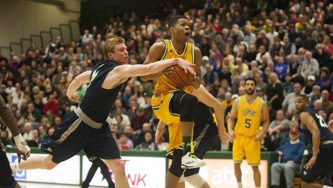 Catamounts guard Trae Bell-Haynes (2) drives to the hoop past Wildcats guard Tommy McDonnell (11) during the men's basketball game between the New Hampshire Wildcats and the Vermont Catamounts at Patrick Gym on Wednesday night.