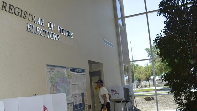 A voter walks into the Tulare County Registrar of Voters office to drop off a Measure H ballot Monday.