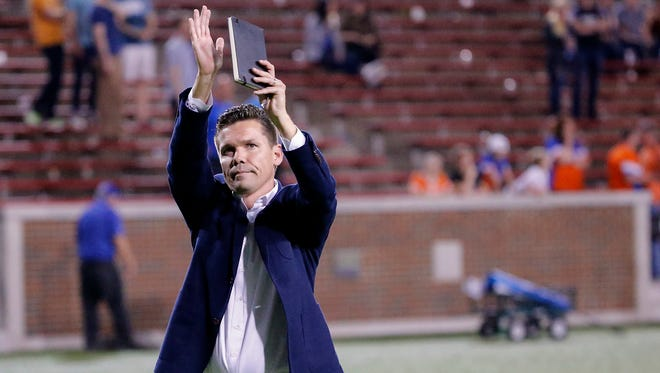 FC Cincinnati manager Alan Koch waves to the fans after the game against the Tampa Bay Rowdies and Futbol Club Cincinnati.