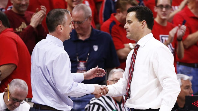 Arizona State head coach Bobby Hurley greets Arizona head coach Sean Miller after the Wildcats beat the Sun Devils 99-61 in Tucson, Ariz., on Wednesday, February 17, 2016.