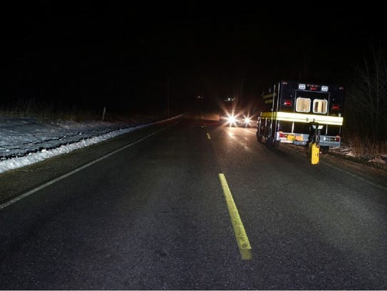 Emergency vehicles respond to the scene of the fatal