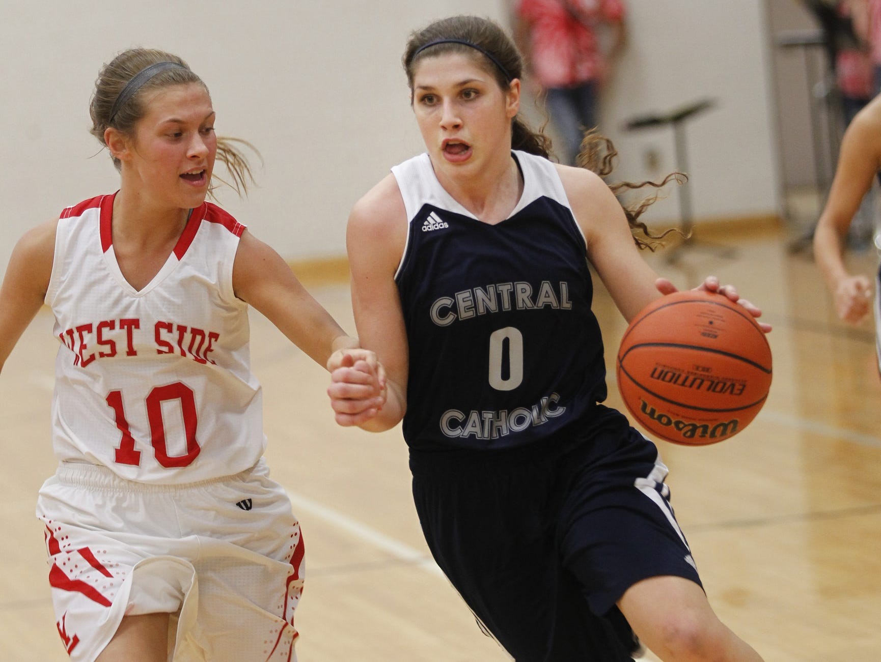 Cameron Onken drives to the basket for Central Catholic while guarded by Abby Martin of West Lafayette Tuesday, January 20, 2015, at West Lafayette High School. CC defeated West Lafayette 50-39.