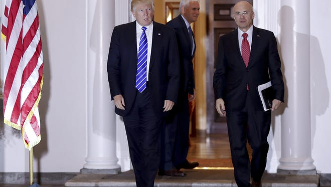 ASSOCIATED PRESS  Restaurant CEO Andrew Puzder was a top senior economic adviser for Donald Trump. President-elect Donald Trump and Andy Puzder, chief executive of CKE Restaurants, walk from Trump National Golf Club Bedminster clubhouse in Bedminster, N.J., Saturday, Nov. 19, 2016. In the background is Vice President-elect Mike Pence.