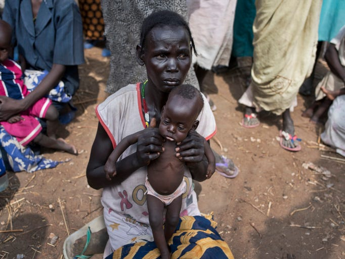 Abuk Garang holds her 7-month-old son William Deng,