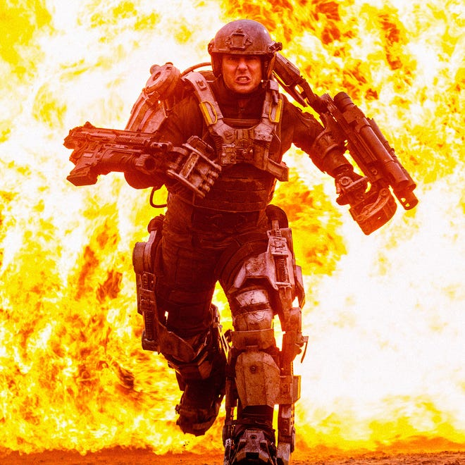 """Tom Cruise in a scene from """"Edge of Tomorrow.""""  AP/Warner Bros. This image released by Warner Bros. Pictures shows Tom Cruise in a scene from """"Edge of Tomorrow."""" (AP Photo/Warner Bros. Pictures, David James)"""