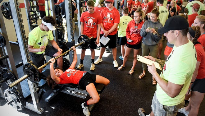 Area athletes lift their best weight for the judges during the Spartan Challenge Tuesday, July 31, 2018 at the Rocori High School in Cold Spring. Area athletes competed in weight lifting, a 40-yard dash, vertical jump and agility events.