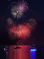 Fireworks explode over Norfork Lake during the 30th annual Independence Eve Fireworks Show on July 3, 2015. The Independence Eve show is one of at least five shows planned for the Twin lakes Area this week.