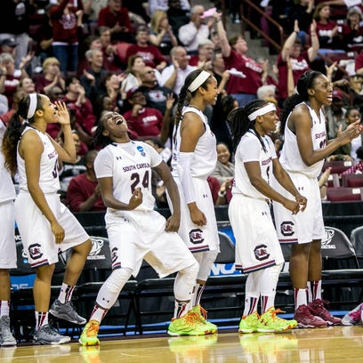 The South Carolina Gamecocks bench reacts in the second