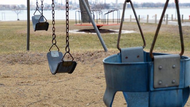 A swing set sits idle Sunday at Marysville City Park.