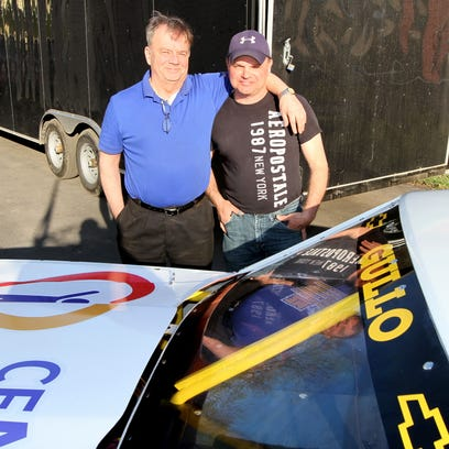 Dave Machuga with the Chevy-bodied Super Stock car he built for Ray Marshall at Tim Gullo's shop on Hall Street in Elmira on Wednesday.