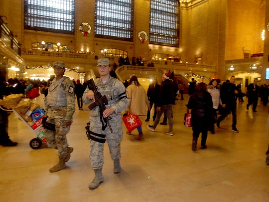 Members of the Army National Guard patrol inside Grand Central Terminal Dec. 11, 2017, hours after a man detonated a pipe bomb in a subway passageway under the Port Authority Bus Terminal.