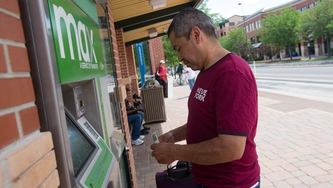 Noe Rodriguez buys tickets for the MAX bus at the Fort Collins Downtown Transit Center on Thursday, June 14, 2018. Transfort announced that it will introduce mobile ticketing for the bus service running north and south on the Mason Street corridor.