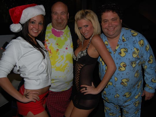 U.S. Congressman Blake Farenthold (right) was photographed next to a model in lingerie and wearing duck pajamas during a Clear Channel Radio Christmas Pajama Party in 2009. After Farenthold was elected to Congress in 2010 the photo circulated on social media and went viral.