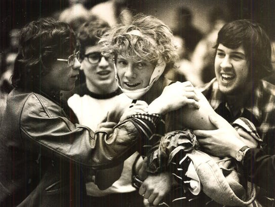 1979: Brian Anderson of Mason City's Newman is congratulated