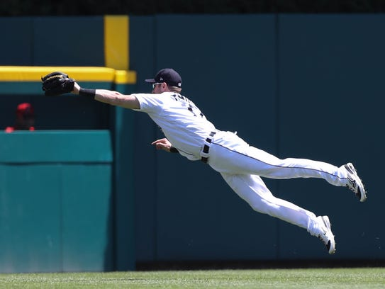 Tigers centerfielder Andrew Romine catches a fly ball