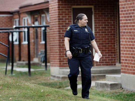 High Point Police Officer B. Williamson tries to serve a domestic violence prevention notification to an offender, in High Point, N.C. The offender was not at home.