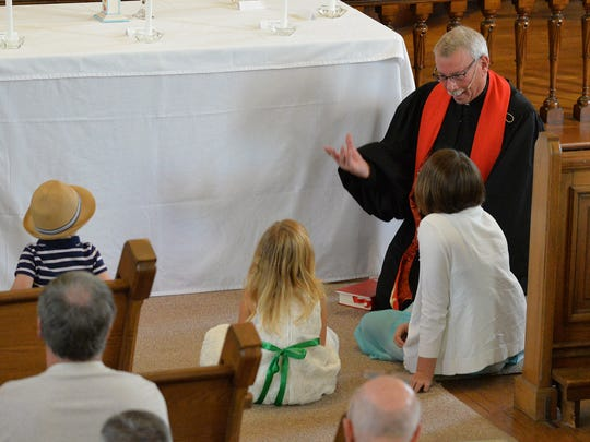 Rev. Bill Long II, retiring pastor of St. John's United Church of Christ, 931 Willow St., Lebanon, shares a message with the children of the church during his final service as pastor of St. John's on Sunday, October 30, 2016.