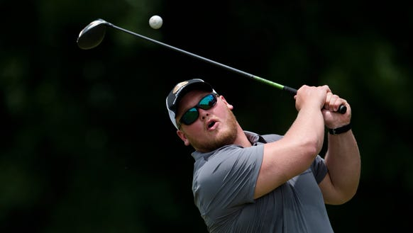 Alabama football's Bradley Bozeman attempts to tee