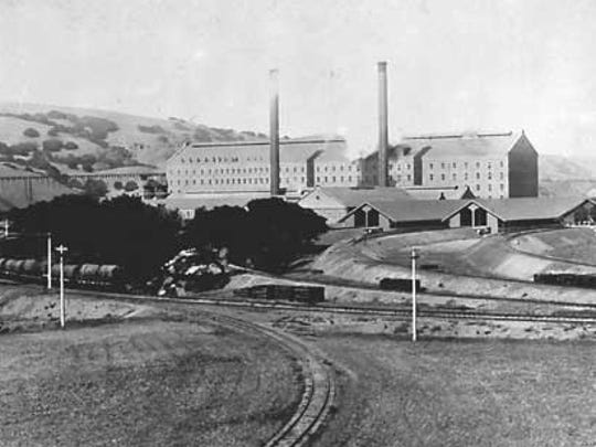 The Spreckels Sugar Factory about 1900. This view shows the railroad bridge crossing the Salinas River.