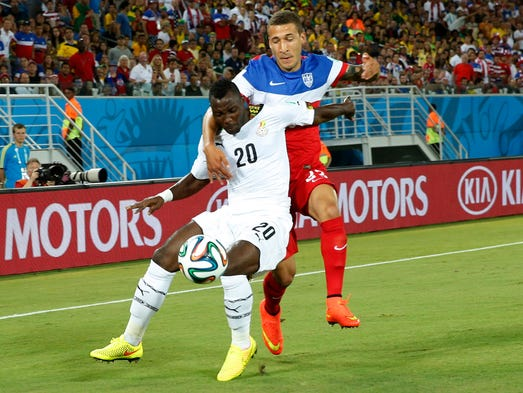 Jun 16, 2014; Natal, Rio Grande do Norte, BRAZIL; Ghana midfielder Kwadwo Asamoah (20) and United States defender Fabian Johnson (23) battle for the ball during the first half of their 2014 World Cup game at Estadio das Dunas.