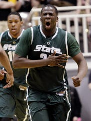 Michigan State forward Draymond Green celebrates a