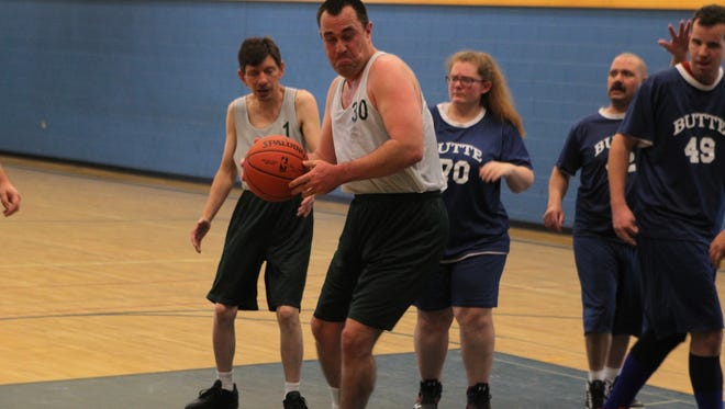 John Morton competes in the Shasta County Special Olympics basketball tournament at Anderson Union High School on Sunday.