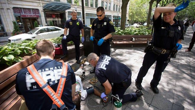 Cincinnati police and fire respond to an overdose at Piatt Park in downtown Cincinnati.