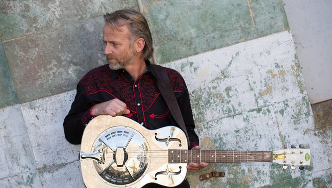 Geoff Achison's soulful voice and virtuosic acoustic guitar style have been favorably compared to Jeff Beck and Warren Haynes.