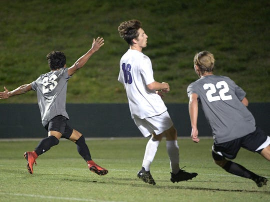 Gulf Coast's Sebastian Joffre (23) celebrates after scoring the game-winning goal in front of Fletcher's Seth Donelan (16) during the overtime period of a Class 4A FHSAA State Soccer Championship game Saturday, Feb. 24, 2018, in DeLand, Fla. Gulf Coast won 2-1. (Phelan M. Ebenhack for the Daily News)
