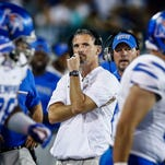 University of Memphis head coach Mike Norvell (middle) watches the scoreboard during third quarter action against Tulane University  at Yulman Stadium in New Orleans.