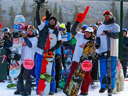 FILE - In this Oct. 21, 2016 file photo, skiers and boarders who have waited in line since Oct. 19 for the first chair react on the opening day of ski season at Arapahoe Basin Ski Area in Colorado as A-Basin becomes the first ski resort in North America to open for the season. The ski industry skews big, with megaresorts adding terrain and attractions. Smaller resorts can't compete with the big guys, so they tout authenticity.