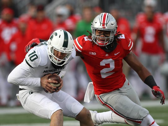 Ohio State's Chase Young sacks Michigan State's Messiah deWeaver in 2017.