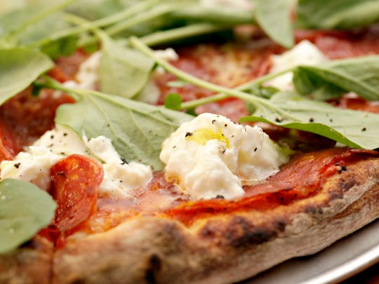 The Calabrian pizza, with calabrese salumi, burrata, and watercress from The Parlor.