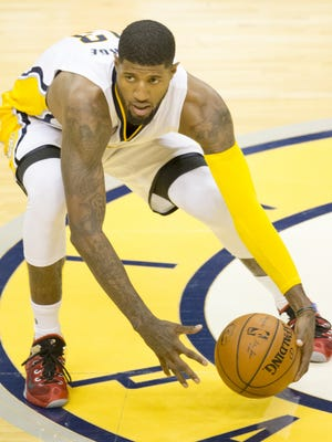 Paul George, who had 19 first quarter points for Indiana, picks up a loose ball, against the Orlando Magic at Indiana Pacers, First Half, Bankers Life Fieldhouse, Indianapolis, Monday, Nov. 9, 2015.