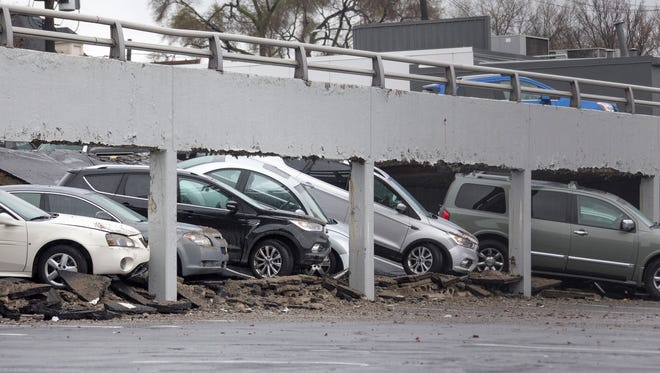 A line of cars crashed through the ceiling of a parking deck at the offices of Matrix Human at the corner of Rivard and Woodbridge in Detroit on Thursday, May 3, 2018.